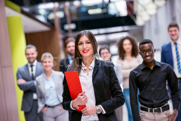бизнеса группа молодые деловые люди ходьбе Сток-фото © dotshock