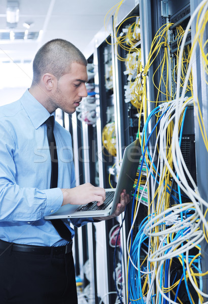 businessman with laptop in network server room Stock photo © dotshock