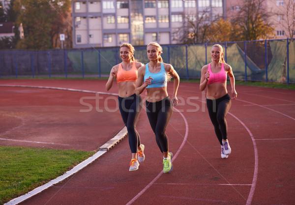 Atlet kadın grup çalışma atletizm yarış pisti Stok fotoğraf © dotshock