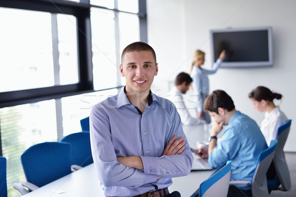 Stock photo: business man  on a meeting in offce with colleagues in backgroun