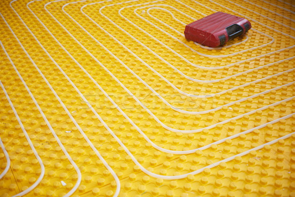 workers installing underfloor heating system Stock photo © dotshock