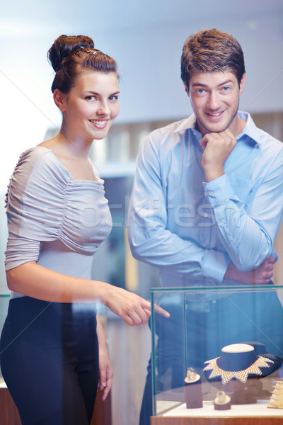happy young couple in jewelry store Stock photo © dotshock