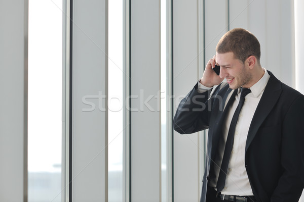 young business man talk by cellphone Stock photo © dotshock