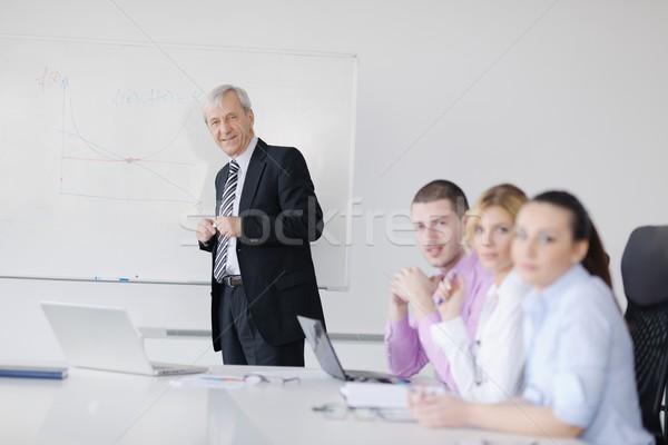 Senior business man giving a presentation Stock photo © dotshock