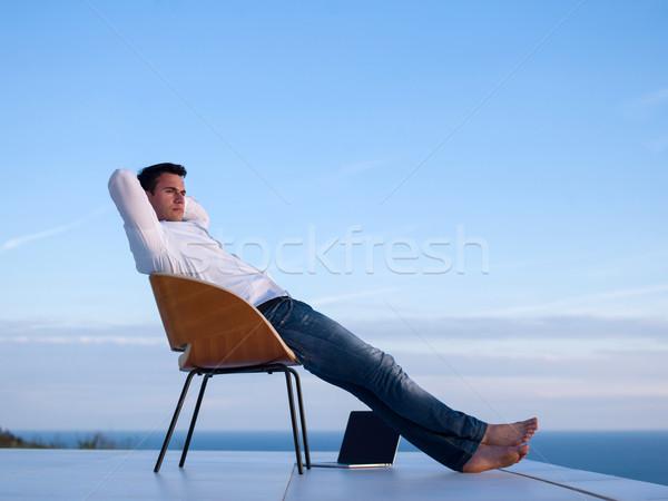 Moço casa varanda bonito relaxante Foto stock © dotshock