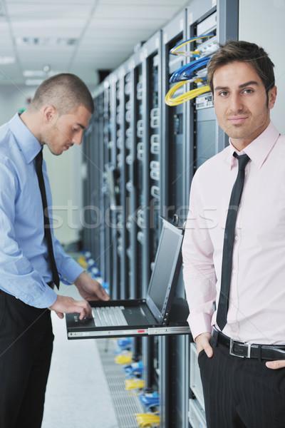 Stock photo: it engineers in network server room
