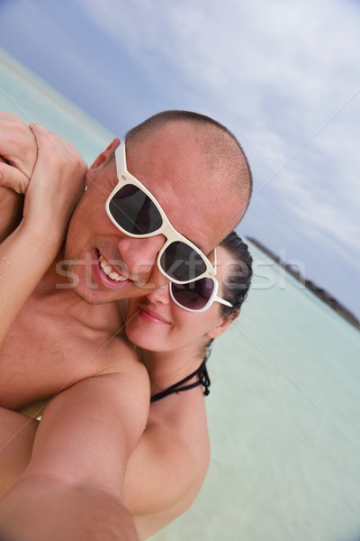 happy young  couple at summer vacation have fun and relax at bea Stock photo © dotshock