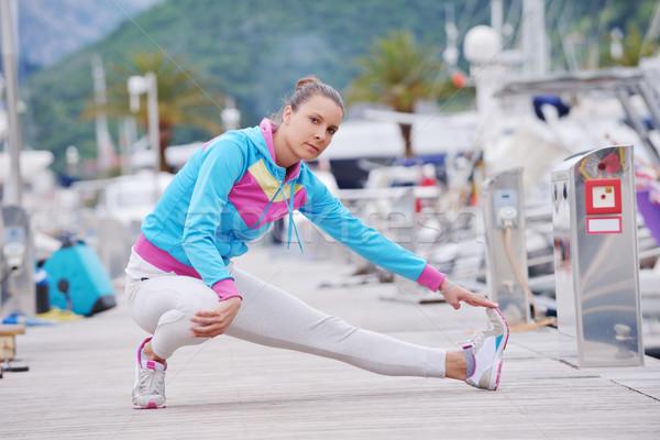 woman jogging in marina Stock photo © dotshock