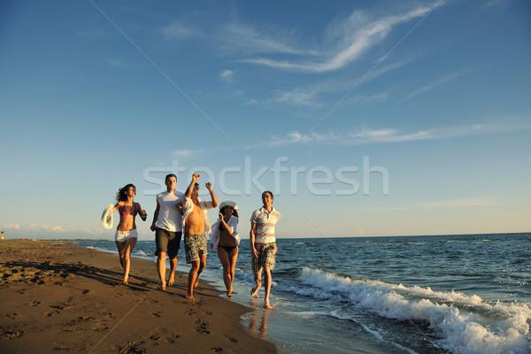Foto stock: Pessoas · grupo · corrida · praia · feliz · jovens