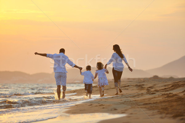 happy young family have fun on beach at sunset Stock photo © dotshock