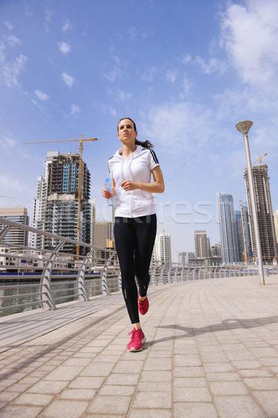 Femme jogging matin courir ville parc Photo stock © dotshock