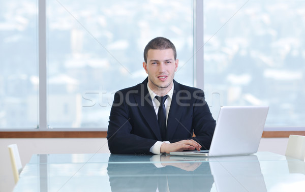 young business man alone in conference room Stock photo © dotshock