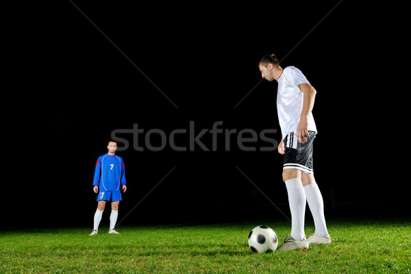 Stock photo: football players in action for the ball