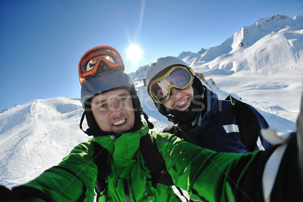 winter portrait of friends at skiing Stock photo © dotshock