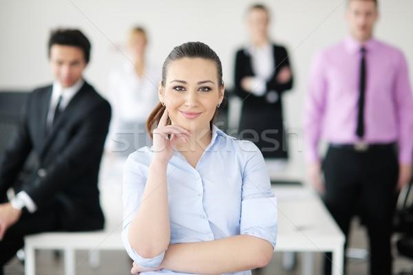 ビジネス女性 立って スタッフ 成功した 現代 明るい ストックフォト © dotshock