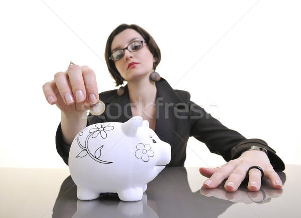 Femme d'affaires argent pièces tirelire jeunes blanche Photo stock © dotshock
