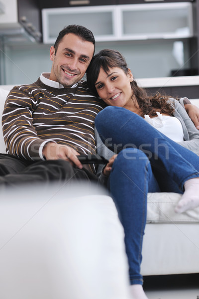 Relaxed young  couple watching tv at home Stock photo © dotshock