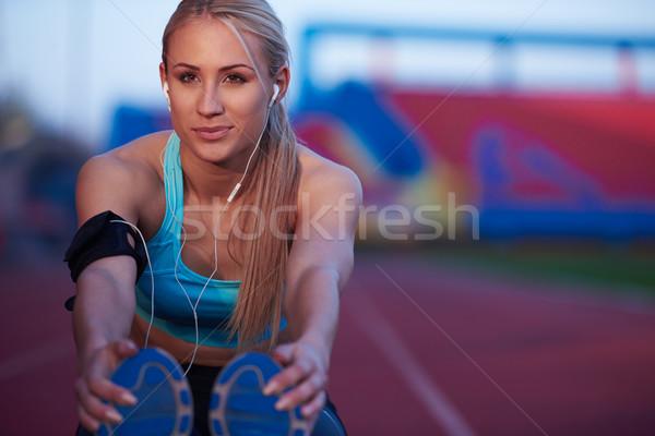 Sportos nő sportos versenypálya fiatal futó Stock fotó © dotshock