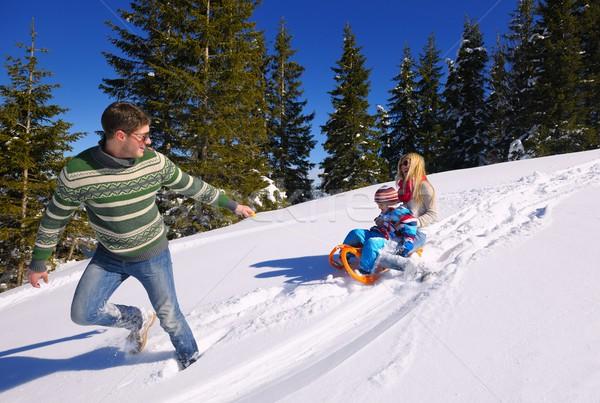family having fun on fresh snow at winter vacation Stock photo © dotshock