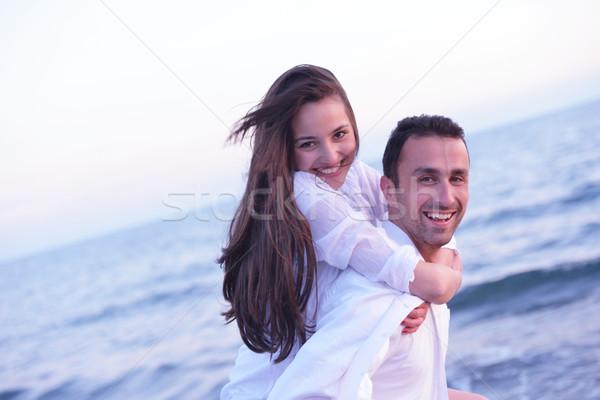 Stockfoto: Strand · leuk · gelukkig · jonge · romantische
