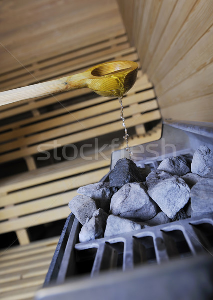 Sıcak taşlar su sauna ahşap Stok fotoğraf © dotshock