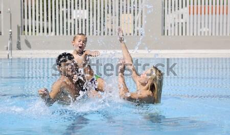 Stockfoto: Gelukkig · vader · zoon · zwembad · leuk · water · glimlach