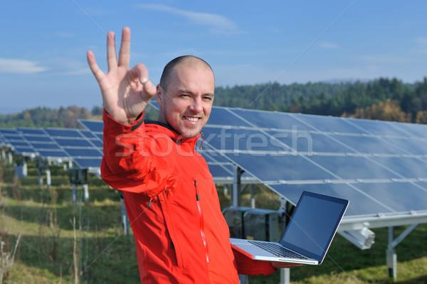 engineer using laptop at solar panels plant field Stock photo © dotshock