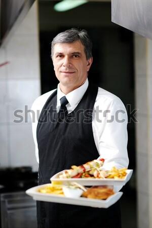 male chef presenting food Stock photo © dotshock