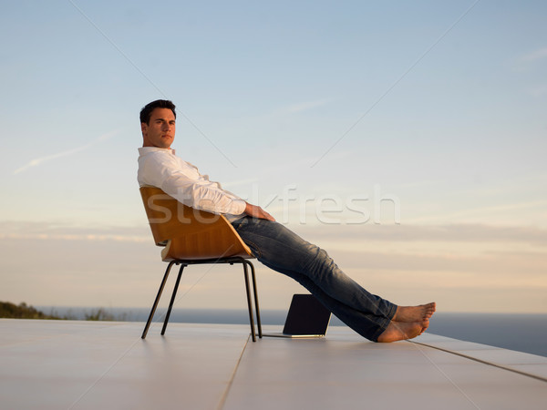relaxed young man at home on balcony Stock photo © dotshock