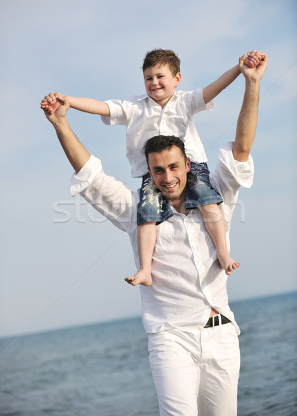 happy father and son have fun and enjoy time on beach Stock photo © dotshock