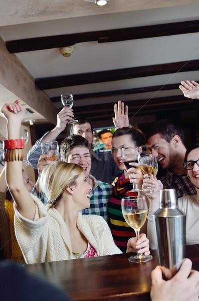 Csoport boldog fiatalok ital bor buli Stock fotó © dotshock