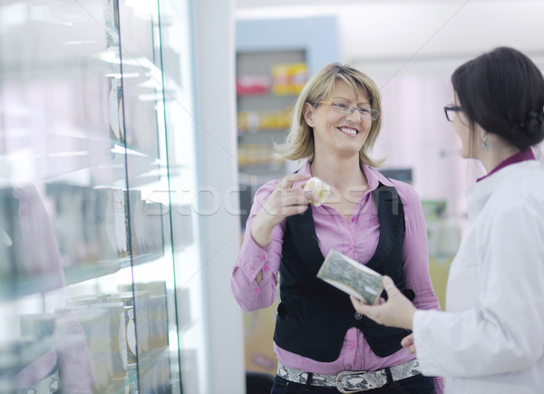 Stock photo: pharmacist suggesting medical drug to buyer in pharmacy drugstore