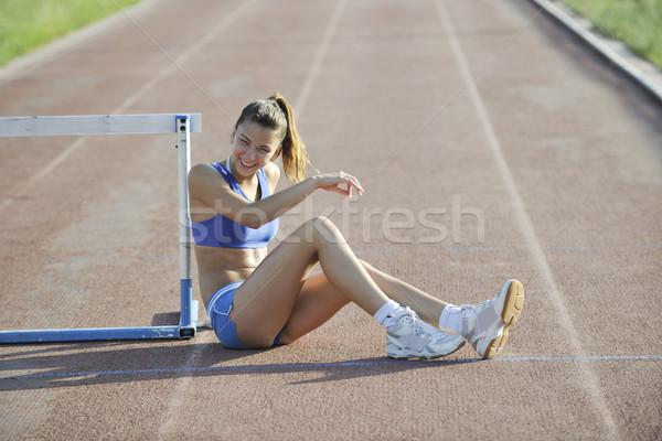 Mutlu genç kadın yarış pisti dinlenmek kadın Stok fotoğraf © dotshock