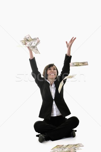 Geld gelukkig jonge zakenvrouw geïsoleerd witte Stockfoto © dotshock