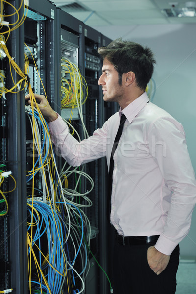 young it engineer in datacenter server room Stock photo © dotshock