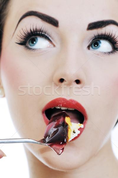 beautiful young woman eat sweet cake Stock photo © dotshock