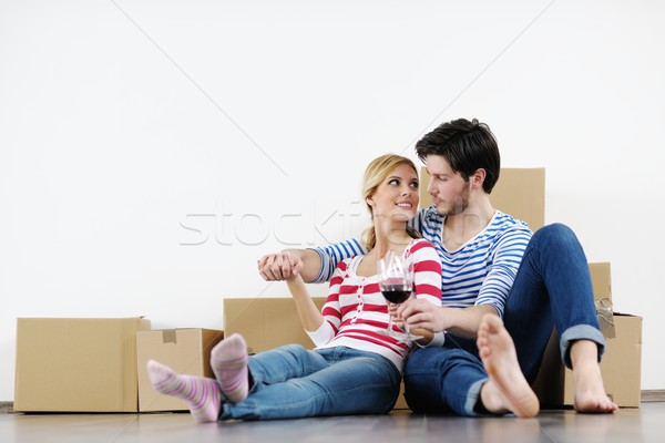 Fiatal pér mozog új ház boldog nő férfi Stock fotó © dotshock