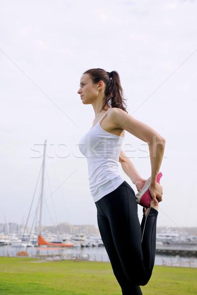 Young beautiful  woman jogging  on morning Stock photo © dotshock