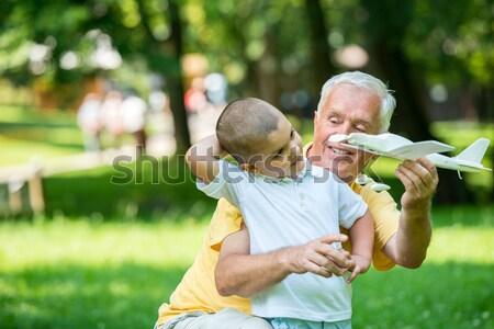 Nagyapa gyermek jókedv park boldog játék Stock fotó © dotshock