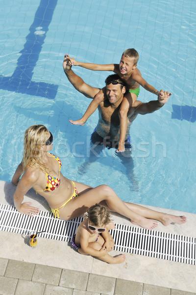 Stockfoto: Gelukkig · jonge · familie · leuk · zwembad · zomervakantie