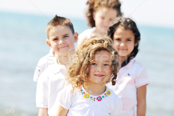 happy child group playing  on beach Stock photo © dotshock