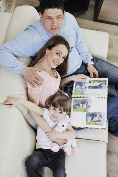 happy family looking photos at home Stock photo © dotshock