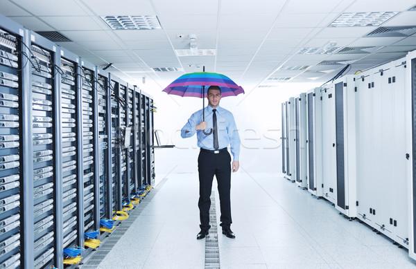 Biznesmen utrzymać parasol serwera pokój młodych Zdjęcia stock © dotshock
