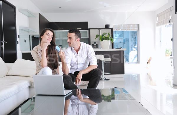 örömteli pár pihen munka laptop számítógép modern Stock fotó © dotshock