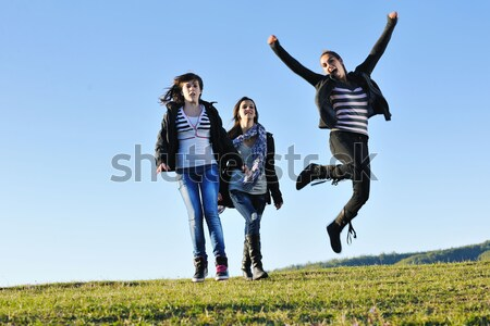 group of teens have fun outdoor Stock photo © dotshock
