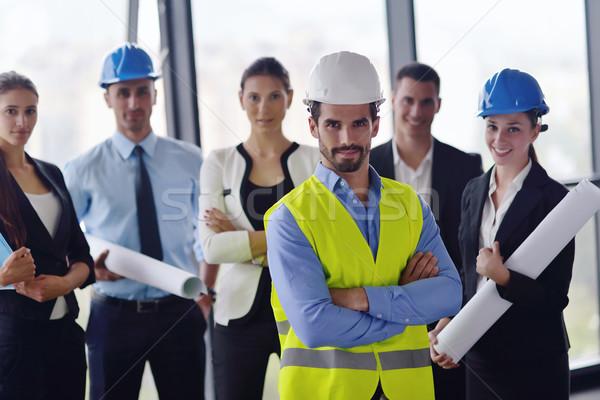Stok fotoğraf: Iş · adamları · mühendisler · toplantı · grup · tanıtım · parlak