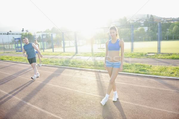 Boldog fiatal nő sportos versenypálya pihen nő Stock fotó © dotshock