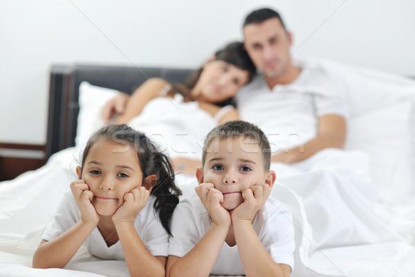 Stok fotoğraf: Mutlu · genç · aile · yatak · odası · eğlence · oynamak
