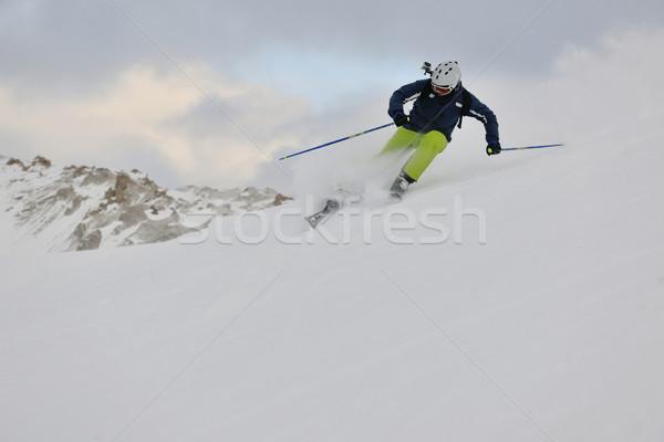 skiing on fresh snow at winter season at beautiful sunny day Stock photo © dotshock