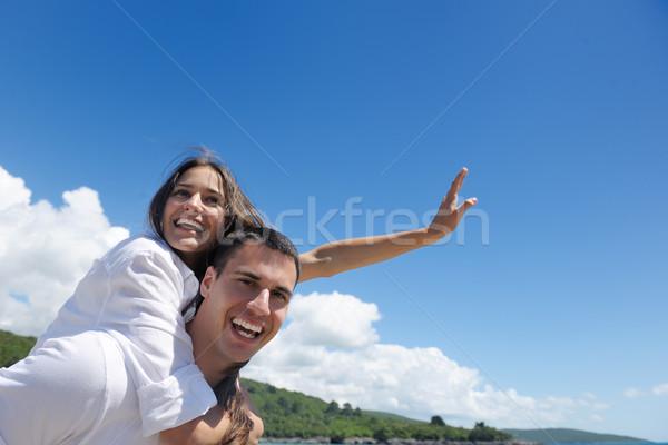 happy couple have fun on the beach Stock photo © dotshock